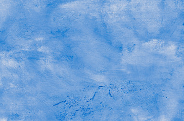 Hand-drawn watercolor abstract background. The texture of the painted wall, splashes, scratches, stains, imitation of a cloudy sky. Primary colors - cyan, white, blue