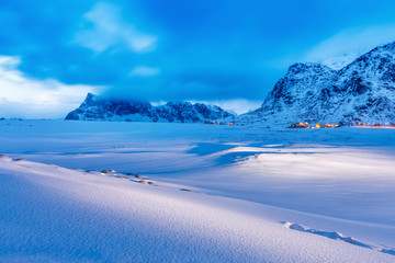 Beautiful northern nature, amazing snowy landscape dusk scene, location Lofoten Islands in Norway over Polar circle.