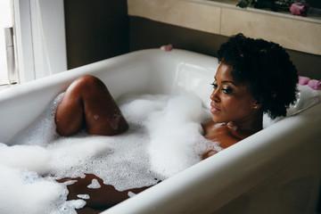 Woman having warm bubble bath