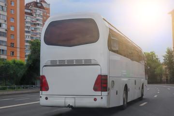 bus moves along a city street
