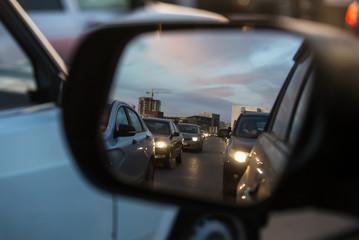 Car traffic in a car mirror