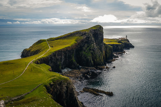 Famous lighthouse on isle of Skye in Scotland, Point nest, view over the approaching path, over the green meadow