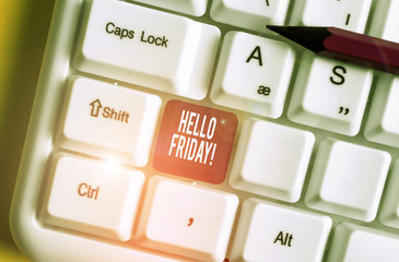 Word writing text Hello Friday. Business photo showcasing you say this for wishing and hoping another good lovely week White pc keyboard with empty note paper above white background key copy space