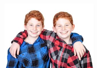 Twin boys in plaid shirts