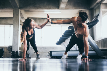 Keuken foto achterwand Fitness Personal trainer helping woman exercising in the sport gym