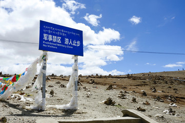 A cautionary trespassing sign marks the beginning of a Chinese military zone in Gampa Pass in Tibet Autonomous Region in China.