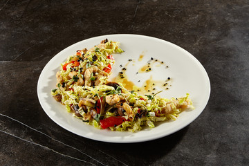 Chinese cabbage salad on white plate