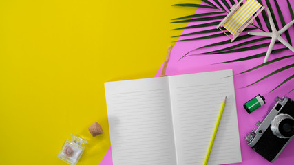 Wall Mural - Top view of colourful summer workspace with blank screen tablet and office supplies on pink and yellow desk