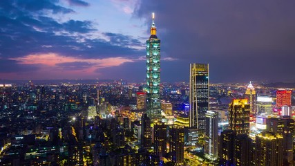Fototapete - Hyper lapse of Cityscapse in Taipei, Taiwan. Aerial view cityscape at night.