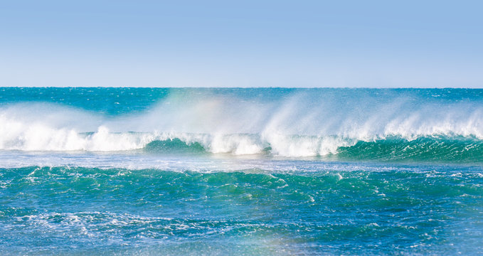 A swell wave approaches the shore