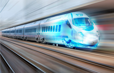 High speed train runs on rail tracks . Train in motion.