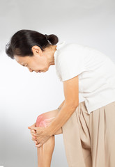 old asian woman touch knee bones pain