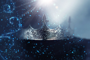 low key image of beautiful queen/king crown over wooden table. vintage filtered. fantasy medieval...