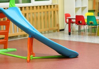 plastic slide in the playground of a kindergarten
