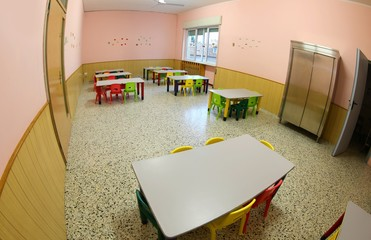 lunchroom with small chairs and tables for a school for the chil