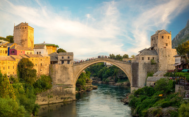 Photo sur Toile Con. Antique Mostar, Bosnia and Herzegovina,The Old Bridge, Stari Most, with river Neretva