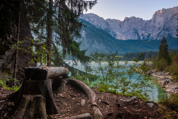 Wall Mural - wooden bench on the shore of a mountain lake