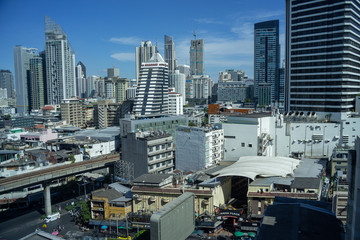 Cityscape skyline of Bangkok Thailand, as seen from Sukhumvit Road, during a sunny day