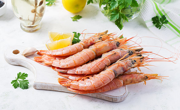 Raw wild Argentinian red shrimps/prawns  and ingredients for cooking. Delicious food. Keto / Paleo Diet.