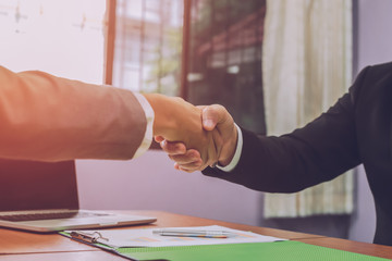 Business people shake hands to demonstrate success in business