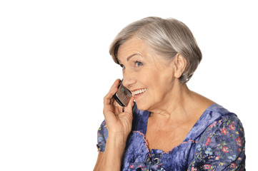 Close up portrait of beautiful senior woman talking on phone isolated on white background