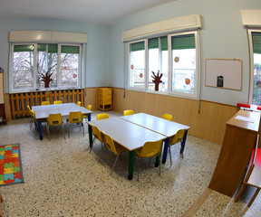 school classroom without children with colorful chairs and small