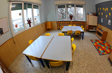 interior of a school class with low tables and small yellow chai