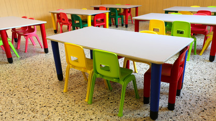 refectory hall with colorful plastic chairs and small tables in