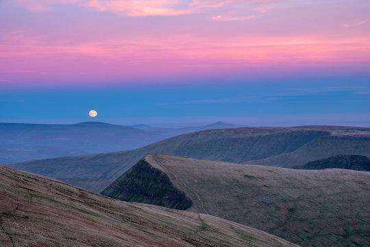 Moonrise over brecon beacons