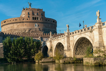 Rome, Italy - October 9, 2019 - view of the sculptures of angels and the castle of the Holy Angel on a background of blue sky