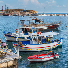 view of small boats in the harbor in the Greek resort town of Hersonissos