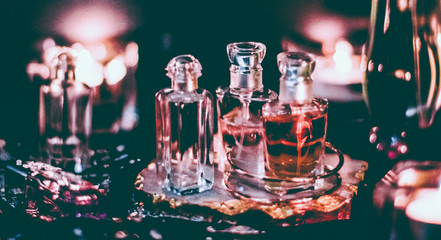 Perfume bottles and vintage fragrance at night, aroma scent, fragrant cosmetics and eau de toilette as luxury beauty brand, holiday fashion parfum design Wall mural