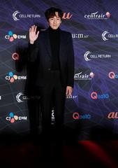 South Korean actor Lee Kwang-soo poses on the red carpet during the annual MAMA Awards at Nagoya Dome in Nagoya