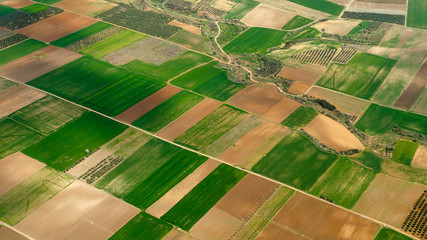 Aerial view of fields with traditional Greek agriculture seen from an airplane window...