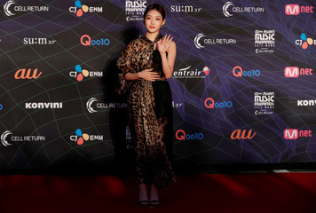 South Korean singer Chung ha poses on the red carpet during the annual MAMA Awards at Nagoya Dome in Nagoya