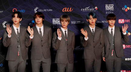 Members of South Korean boy band TXT pose on the red carpet during the annual MAMA Awards at Nagoya Dome in Nagoya