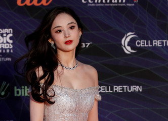 Chinese actress Guli Nazha poses on the red carpet during the annual MAMA Awards at Nagoya Dome in Nagoya