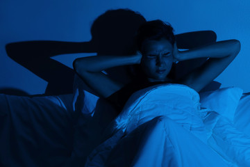 Woman with insomnia because of loud noises