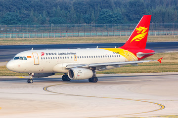 Capital Airlines Airbus A319 airplane Beijing airport