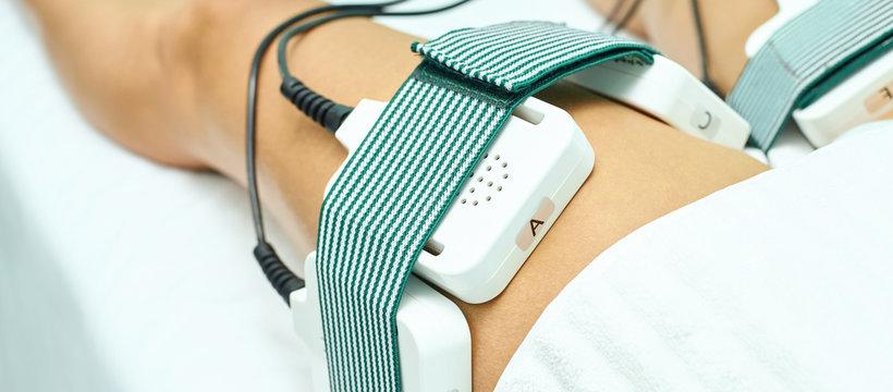 Laser lipo equipment. Cosmetic fat reduce treatment. Woman in medicine salon. Anti cellulite procedure