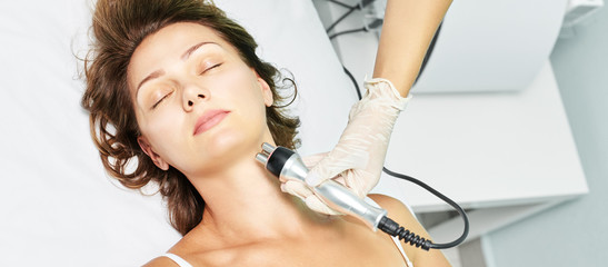 Dermatology skin care facial therapy. Medical spa anto wrinkles procedure. Woman face rejuvenation. Pretty girl. Rf cosmetician equipment. Chin and neck