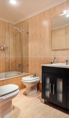 Interior of bathroom with mirror and shower screen