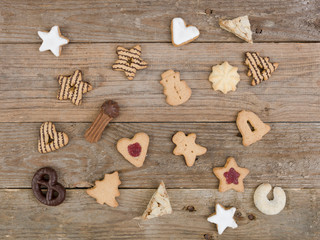 many different nice christmas cookies on wooden background photo taken from above