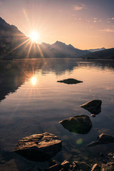 Poster de jardin Noir Sunrise on rocky mountain with rocks in Medicine lake at Jasper national park