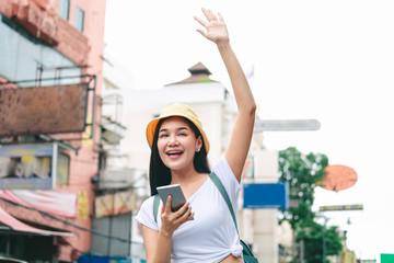 Traveler woman using mobile phone in bangkok city