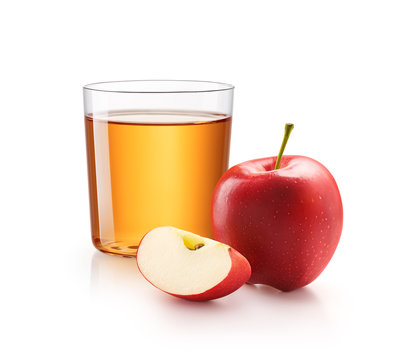 A glass of apple juice with red apples isolated on white background