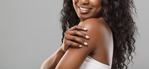 Fototapete - Unrecognizable black woman enjoying her smooth skin over grey background