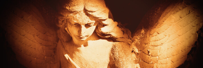 Fototapete - Beautiful facial expression of an ancient statue of guardian angel