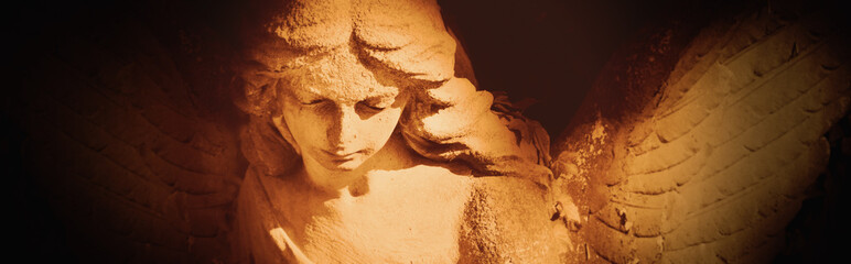 Fototapete - Religion concept. Beautiful facial expression of an ancient statue of guardian angel