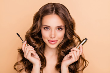 Close up photo of charming attractive lady hold mascara want prepare for date isolated over beige color background